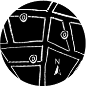 a map grid with compass and directions marked on the map drawn with chalk on a blackboard